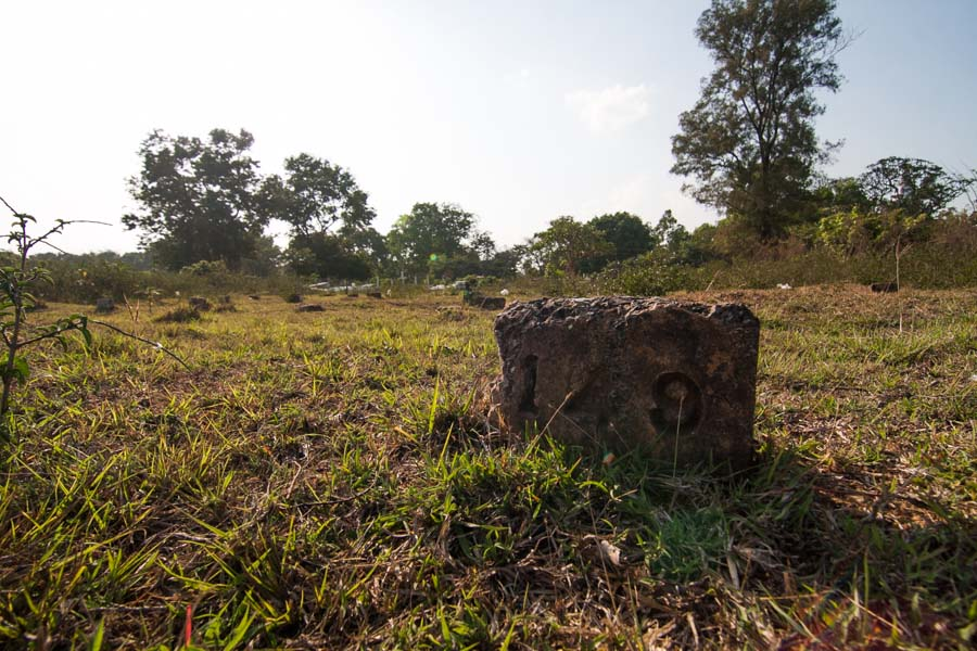 Plot markers stand silently at an abandoned Christian cemetery in Pyin Oo Lwin